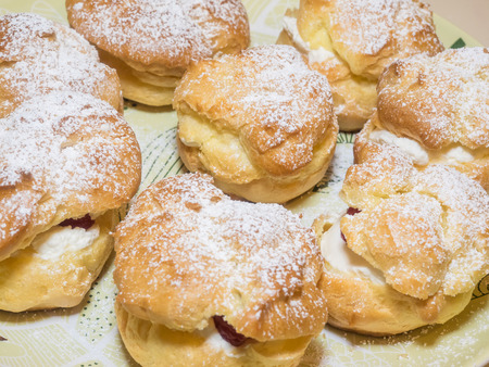 profiterole: Homemade choux pastry ball filled with whipped cream, pastry cream. Stock Photo