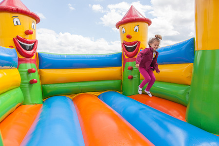 Having fun playing in inflatable jump house. Banco de Imagens
