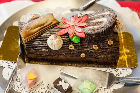 Yule log is a traditional dessert served near Christmas. It can be considered a type of sweet roulade. photo