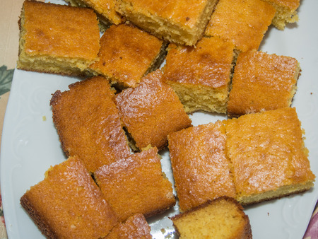 cornbread: Cornbread is a generic name for any number of quick breads containing cornmeal. They are usually leavened by baking powder.