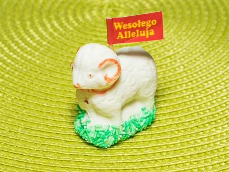 paschal: Sugar paschal lamb may be used as a decorative centerpiece to the basket that is taken to Easter mass. Stock Photo