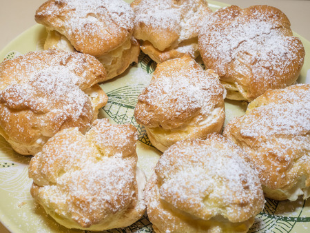 Homemade choux pastry ball filled with whipped cream, pastry cream. Reklamní fotografie