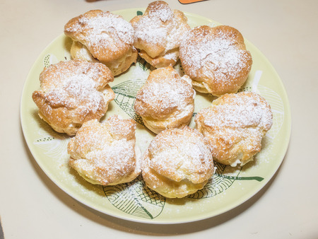 Homemade choux pastry ball filled with whipped cream, pastry cream. photo