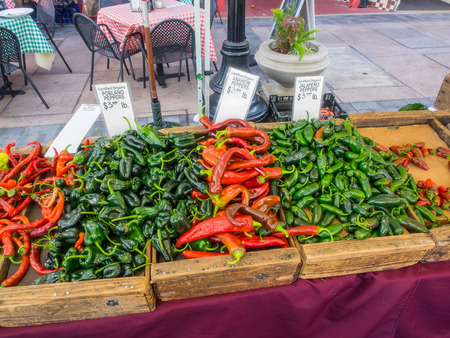 mild: Three types of peppers,Poblano,Anaheim and Jalapeno for sale at local farmers market. Stock Photo