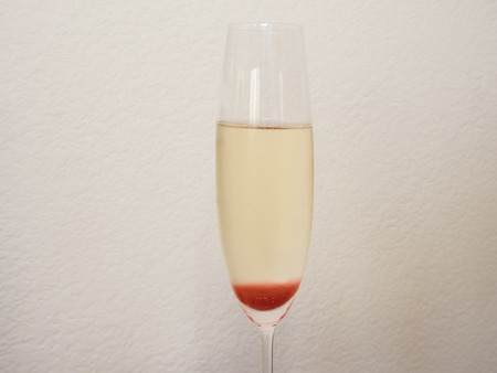 Strawberry Bellini is a mixture of sparkling wine and strawberry syrup. 版權商用圖片