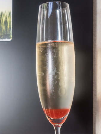 bellini: Strawberry Bellini is a mixture of sparkling wine and strawberry syrup. Stock Photo