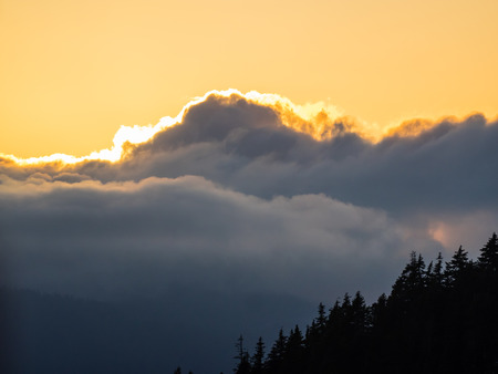 Colorful clouds during sunset on the top of Grouse Mountain photo