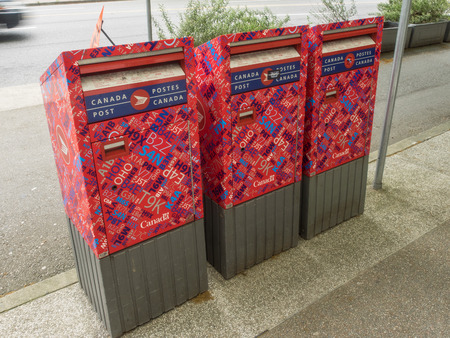 Canada Post red street letter boxes conveniently located on street corners, in shopping centres and at public transit locations. Stock Photo