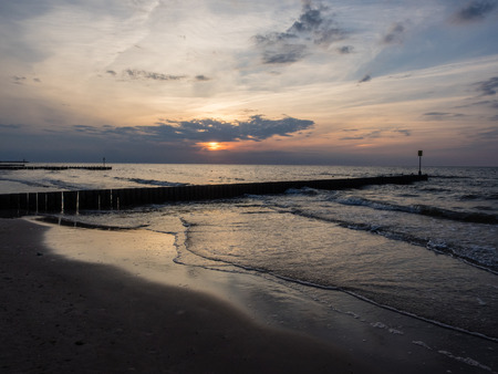 Walking on the beach in Kolobrzeg between sunset and twilight.