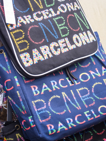 Barcelona souvenir stand with colorful backpack