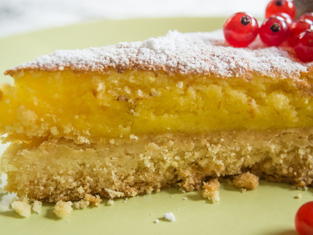 Lemon tart have a pastry shell with a lemon flavoured filling.