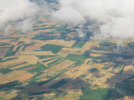 View of the ground from airplane window during flight