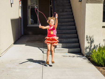 Learning how to jump rope on sunny summer day. photo