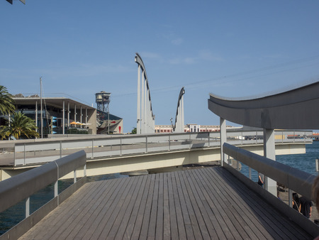 incorporates: Rambla de Mar, connects La Rambla to Port Vell. It incorporates a swing bridge, in order to allow ships to enter and exit the harbour.