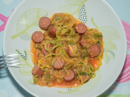 Squash spaghetti noodles with sausage and tomato sauce.