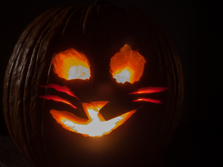 Jack-o'-lantern is a carved pumpkin, associated chiefly with the holiday of Halloween.