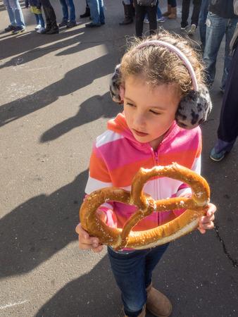 girl holding food