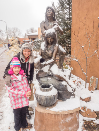 squaw: Statue of native indians in front of souvenir shop in downtown Santa Fe, NM.
