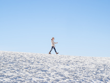 Field of white sand dunes composed of gypsum crystals.  photo