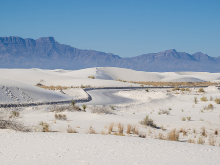 White Sands National Monument is a field of white sand dunes composed of gypsum crystals. It is the largest gypsum dune field in the world.