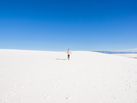 White Sands National Monument is a field of white sand dunes composed of gypsum crystals. It is the largest gypsum dune field in the world. photo