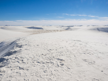 white sands national monument: White Sands National Monument is a field of white sand dunes composed of gypsum crystals. It is the largest gypsum dune field in the world.