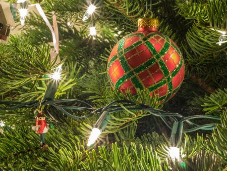 festoon: Christmas ornaments are decorations (usually made of glass, metal, wood or ceramics) that are used to festoon a Christmas tree.