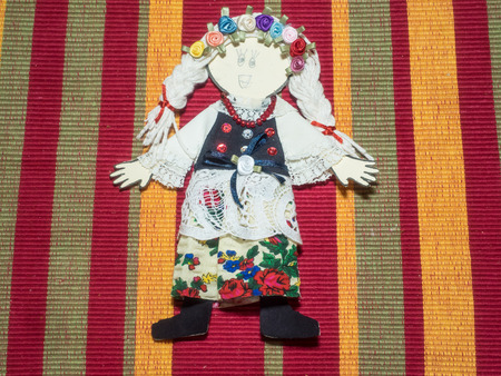 paper art projects: School project depicting ethnic polish doll.