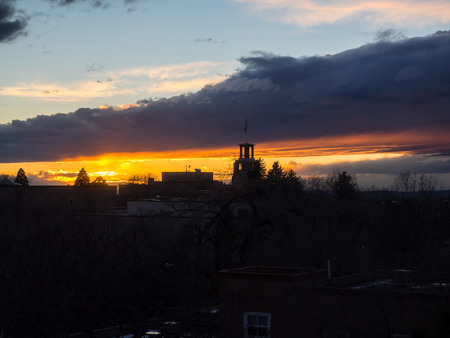 Colorful sunset over the cityscape in Santa Fe, NM Stock Photo
