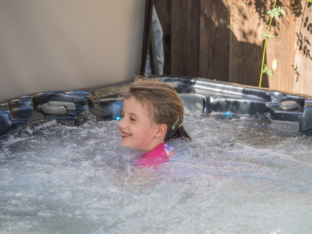 hot tub: Having fun in hot tub in backyard