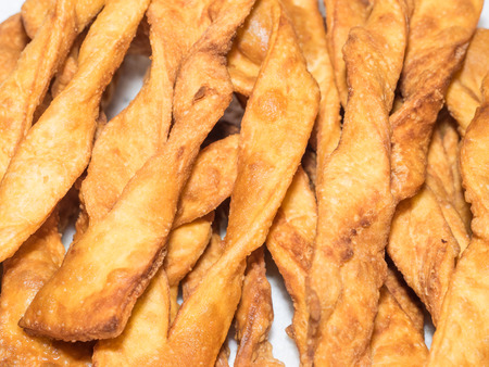Angel wings are a traditional sweet crisp pastry made out of dough that has been shaped into thin twisted ribbons, deep-fried and sprinkled with powdered sugar.