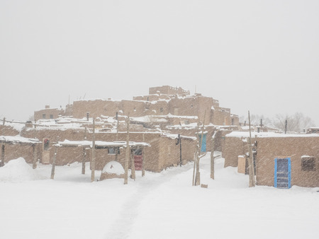 adobe pueblo: Taos Pueblo is an ancient pueblo belonging to a Tiwa-speaking Native American tribe of Pueblo people.