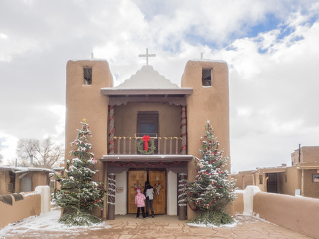 adobe pueblo: Mission church was constructed near the west gate of the Taos Pueblo wall.