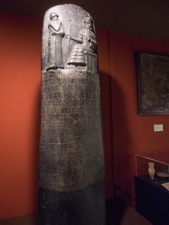 stele: Law Code of Hammurabi inscribed on a basalt stele in the Akkadian language in the cuneiform script. These laws stand as one of the first written codes of law in recorded history. Stock Photo