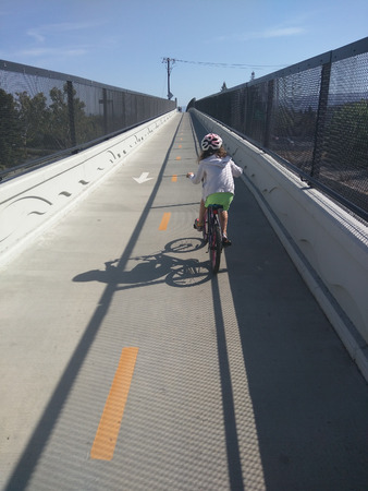 road cycling: The Permanente Creek Trail is a multi-use trail that extends from Shoreline At Mountain View over Highway 101, under Old Middlefield Road and currently ends at Rock Street. Stock Photo