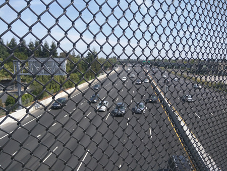 overpass: View of Highway 101 through fence from overpass.