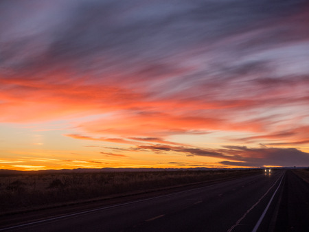 asphalt road: Sunset over U.S. Route 82 in New Mexico in December.