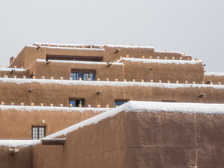 adobe pueblo: Inn and Spa at Loretto is a resort with pueblo-inspired architecture in Santa Fe, NM. Stock Photo