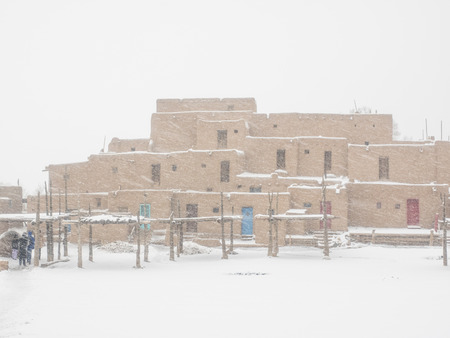 belonging: Taos Pueblo is an ancient pueblo belonging to a Tiwa-speaking Native American tribe of Pueblo people.