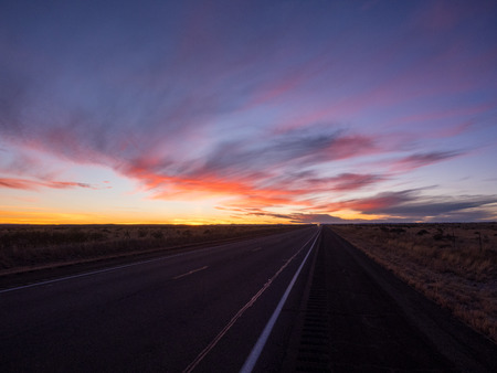 endless road: Sunset over U.S. Route 82 in New Mexico in December.