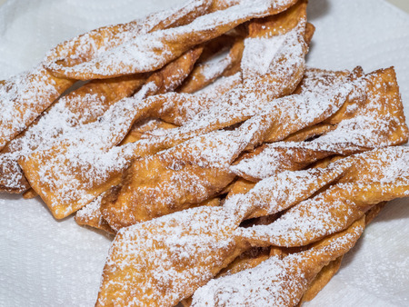 Angel wings - traditional sweet crisp pastry made out of dough that has been shaped into thin twisted ribbons,