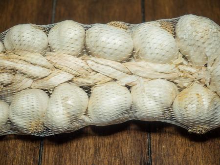 medium size: Medium size garlic braid on wooden table