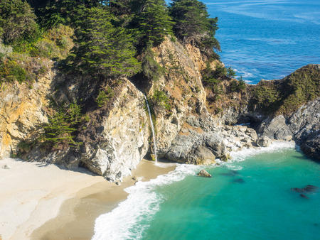 mcway: McWay Falls is an 80-foot waterfall located in Julia Pfeiffer Burns State Park that flows year-round. Stock Photo