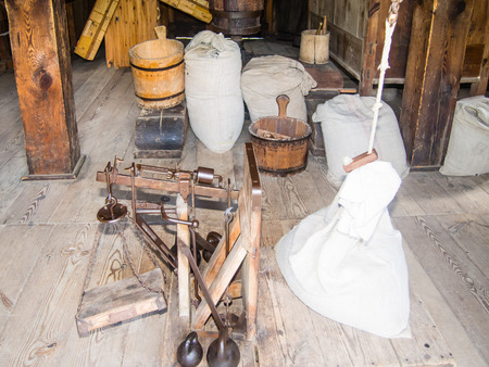smock: Vintage milling devices inside old smock windmill. Stock Photo