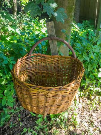 medium size: Medium size vintage wicker basket with handle Stock Photo