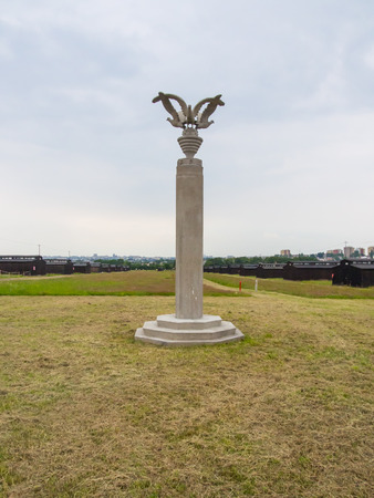 erecting: Column of Three Eagles was made by Polish prisoners according to Albin Maria Boniecki's design. The pretext for erecting the sculpture was the planned visit by the International Red Cross.