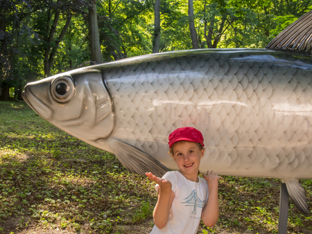 stroll: Admiring large fish sculptures during stroll in Kolobrzeg, Poland