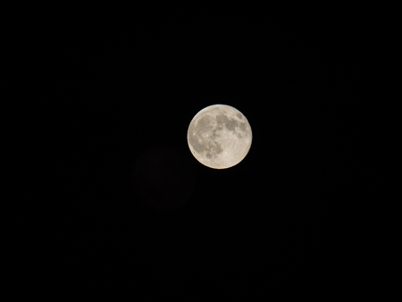 coincidence: Supermoon is the coincidence of a full moon or a new moon with the closest approach the Moon makes to the Earth on its elliptical orbit, resulting in the largest apparent size of the lunar disk as seen from Earth. Stock Photo