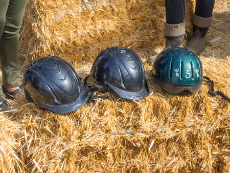 headgear: Equestrian helmet is a form of protective headgear worn when riding horses
