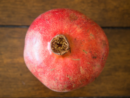 granatum: Pomegranate (Punica granatum) is a fruit-bearing deciduous shrub or small tree growing between 5 and 8 m (16 and 26 ft) tall.